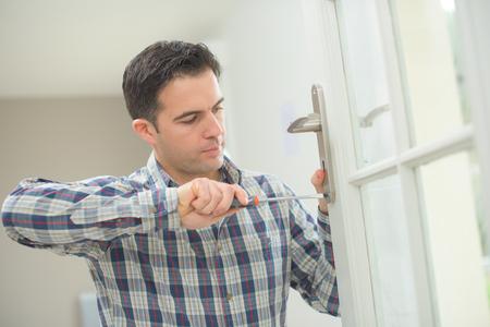man installing impact resistant doors